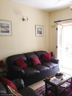 Comfortable three seater sofa for relaxing and TV viewing.