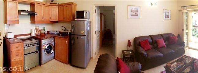 Panoramic view of the kitchen and living room.