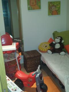 Childs bedroom...full size single bed...toys, cot and high chair