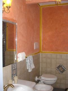 Bathroom with sink, toilet, bidet and shower