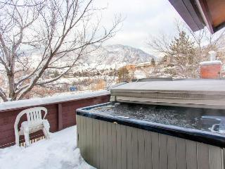 Condo with private hot tub, gorgeous mountain views, & cozy gas fireplace