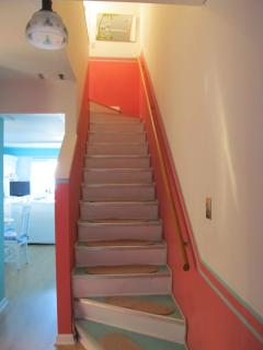 Steps leading to your upstairs with King bedroom and Full/Twin bedroom and full bath.