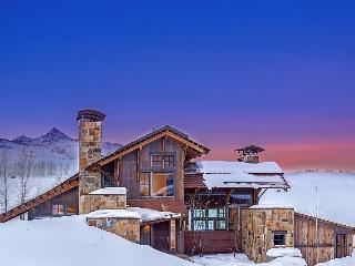 Enjoy sweeping views of the mountains along with peace and quiet in your beautiful vacation home next to Telluride Ski and Golf Club.