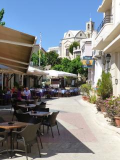 Pissouri Village cobbled square with bars, tavernas/restaurants, Church, banks and supermarket