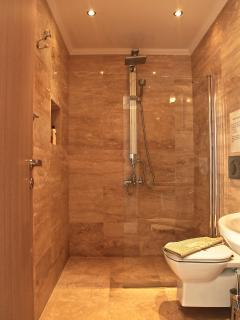 All bathrooms have a mediterranean travertine finish