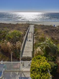 view of boardwalk to the beach from your covered balcony 28 steps to the sand