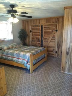 Another view of downstairs bedroom with two queen beds and bathroom