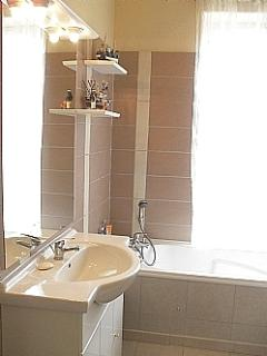 Family Bathroom with sink shower cubicle bath and toilet