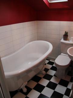 Bathroom with roll top bath.