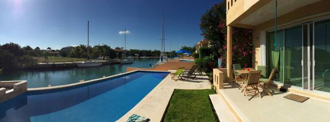 Our large patio offers beautiful views of our pristine pool, boats, dock and canal w/ tropical fish!