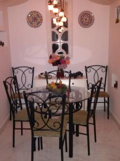 lovely Moorish style dining area with glass table and six chairs