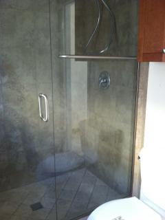 Remodeled bath with walk-in shower.