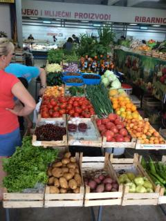 Organic fruit + veg,cheeses,meat +fish in market.