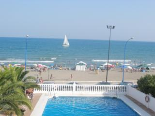 Holiday in the Sun. Beachfront Apartment with Pool and Sea Views with free WIFI.