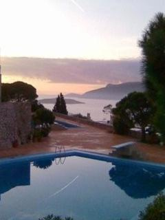 sunset over the pool and terrace looking out to sea