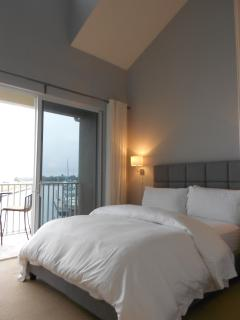 Master bedroom retreat with balcony view of canal and marina