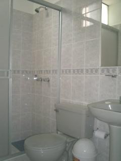 Bathroom with stand shower