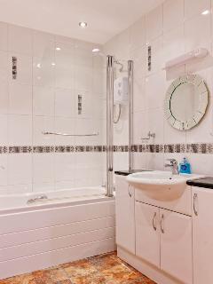 Large, modern, ground floor bathroom with heated towel rail