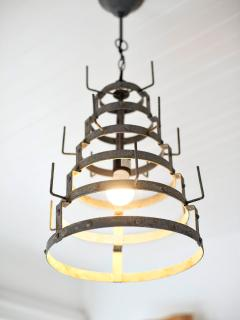 This French Vintage Wine Bottle Drying Rack, 'Herrison', was converted into a unique light fixture.