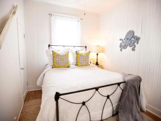 The 2nd bedroom, with its nautical curb appeal, also has a plush queen size bed & luxurious linens.