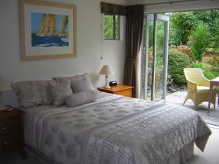 main bedroom, bifold doors open up to the deck and garden