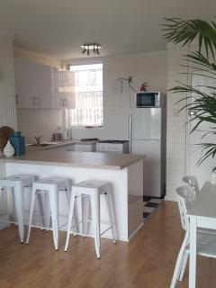 Spacious kitchen with breakfast bar and dining table