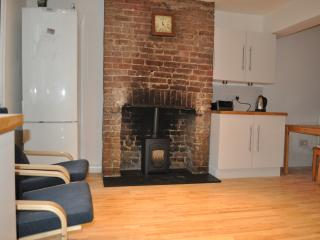 Kitchen area with working wood burner.  A great space to spend time with family and friends