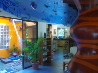 The centerpiece of our home is our 40' undersea mural consisting of handmade 3D sealife sculptures!