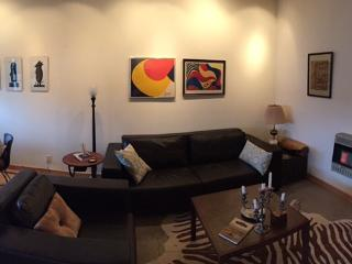 Back to the Living Room:) A chocolate leather sofa framed Calder prints behind the sofa ...