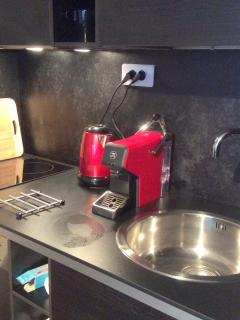 The well-appointed kitchen includes a ceramic hob, extractor, dishwasher and fridge/freezer.