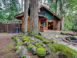Discover peace and tranquility at this riverfront cabin among the trees., Welches