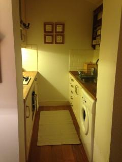 Galley kitchen. Combi Microwave/Oven, gas hob, kettle, toaster and washing machine.