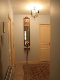 the hall leading to the 3 bedrooms