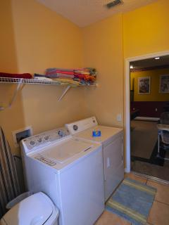 Full-size laundry room with washer and dryer