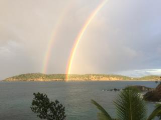 Beautiful twin rainbows taken by a guest December 2014. Looking off the deck toward Inner Brass Is.
