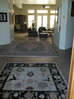 VIEW FROM ENTRY WAY OF FOYER AND LIVING ROOM (Shared)