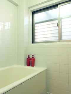 Clean bathroom with bath tub and shower