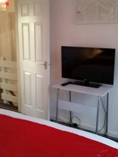 large flatscreen in main bedroom