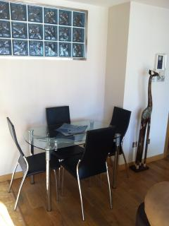 Should the need arise, the modern dining table and chairs will comfortably accommodate 4 people