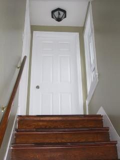 From just inside the main front door you will see the interior stairs up to the 2nd floor unit.