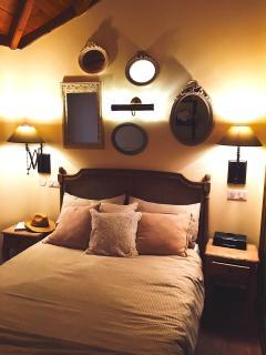 Cozy bedroom with veranda door to private outdoor bathroom with bath-tub under the stars