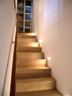 Stone steps leading up to the two bedrooms on the second level