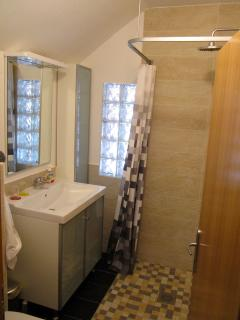 Bathroom with rain shower, top level located to left of stairs