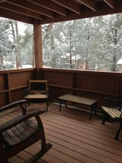 View from 1st level deck off of the Living Room while it is snowing