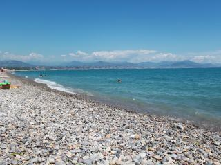 Beach by the apartment. Snowy french alps in background