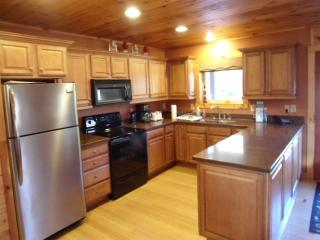 Large, open kitchen, with bar area & all the appliances from home.
