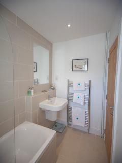 family bathroom with heated de-misting mirror