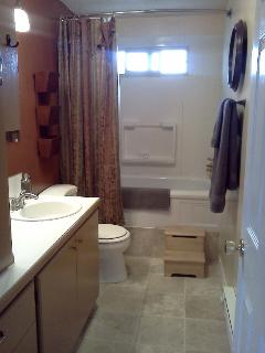 Single bath/shower. Includes towels& travel size toiletries.
