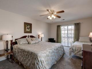 Master Bedroom w/ comfortable king-size Bed, day bed & sliding doors to large deck.