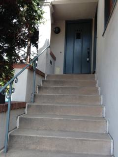 Steps to the front door from the landing